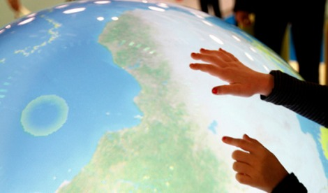 Children play with an interactive globe in the Forum exhibition Hall, the site of the Bright Green Conference. United Nations Climate Change Conference (COP15) was held at Bella Center in Copenhagen from the 7th to the 18th of December, 2009. A great deal